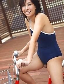 Ageha Yagyu in spandex bath suit shows curves on bike
